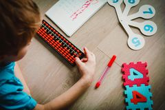Little boy learning numbers, mental arithmetic, abacus. Calculation Royalty Free Stock Photography