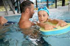 Little boy learning swimming with armbands Stock Photography