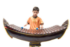 Little boy learning Thai instument Xylophone, Ranat, on white background. Little boy learning Thai instument Xylophone, Ranat Royalty Free Stock Photos