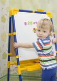 A little boy learning to count. Royalty Free Stock Photos
