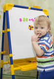 A little boy learning to count. Stock Photo
