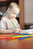 Little boy is learning to draw (focus on pencils) Stock Photo