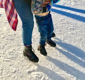Little Boy Learning to Ice Skate royalty free stock photography