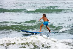 Free Little Boy Learning To Surf In The Stand On Board Stock Photo - 166470150