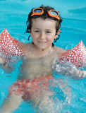 Little boy learning to swim royalty free stock photos