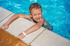 Little boy learning to swim. Stock Photos