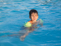 Little boy learning to swim Stock Photos
