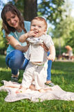 Little boy is learning to walk with the support of my mother's h Stock Image