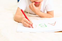 Little boy learning to write letters Stock Photography