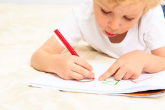 Little boy learning to write letters Royalty Free Stock Image