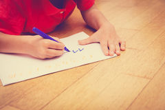 Little boy learning to write numbers. Home school learning homework concept -little boy learning to write numbers Royalty Free Stock Photos