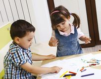 Little boy learns their girlfriend alphabet Royalty Free Stock Photos