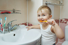 Little boy learns to brush teeth royalty free stock photos