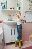 Little boy learns to brush teeth royalty free stock photography