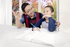 Little boy learns to count with his father Stock Image