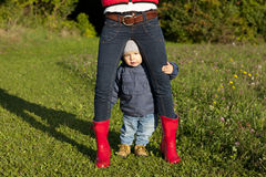 Little boy between the legs of his mother Stock Photo