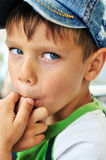 Little boy licking his finger Royalty Free Stock Photography