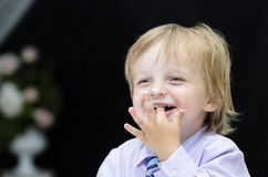 Little Boy Licking his Forefinger Stock Photography