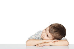 Little boy lies and dreams. Royalty Free Stock Photography