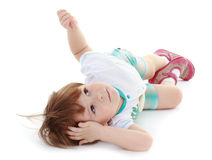 A little boy lies. Very tired little boy lying on the floor. Isolated on white background Stock Image