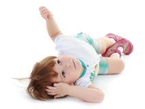 A little boy lies. Stock Image