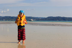 Little boy in life jacket on the beach Royalty Free Stock Photos