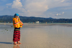 Little boy in life jacket on the beach Royalty Free Stock Images