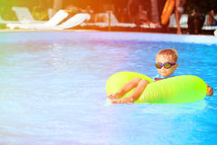 Little boy in life ring fun at the swimming pool Royalty Free Stock Image