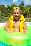 Little boy in a lifejacket Stock Images
