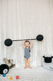 Little boy lifting toy weight Royalty Free Stock Photos