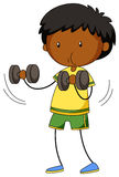 Little boy lifting weights Stock Image
