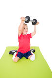 Little boy lifts weights Royalty Free Stock Image