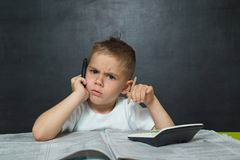 Little boy  like businessman in office with newspaper Royalty Free Stock Photos