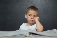Little boy  like businessman in office with newspaper Stock Photography