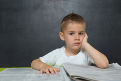 Little boy  like businessman in office with newspaper Royalty Free Stock Photography