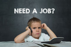 Little boy like a Businessman with text NEED A JOB Stock Images