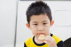 Little boy like eat snacks Stock Photos