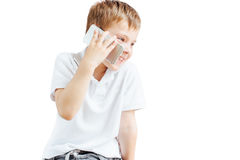Little boy listen music and talk on phone with white background Royalty Free Stock Photo