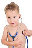 Little boy listen to heart sounds Stock Photography