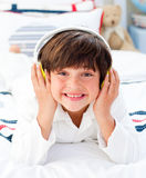 Little boy listening music with headphones on Royalty Free Stock Photography
