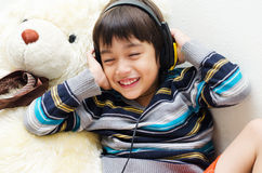 Little boy listening the music with headset Royalty Free Stock Photography