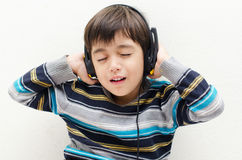 Little boy listening the music with headset Stock Photography