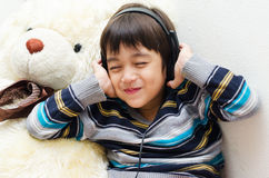Little boy listening the music with headset Royalty Free Stock Photos