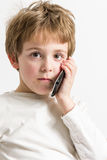 Little Boy listening a phone call Royalty Free Stock Images
