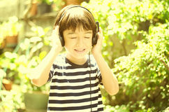 Little boy listening the sound of nature vintage style Stock Images