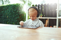 Little boy listening to his selected soundtrack Royalty Free Stock Images