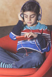 Little boy listening to music Stock Photos