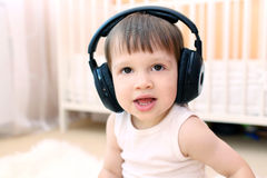 Little boy listening to music Stock Image