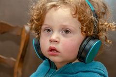 Little boy listening to music with headphones stock photo