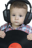Little boy listening to music with headphones Stock Photos